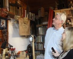 """John Frame shares his studio and cabinet of curiosities during his interview with Jill Thayer in Wrightwood, CA for """"In Their Own Words: Oral Histories of CGU Art."""" Photo courtesy of January Parkos Arnall (2011)."""