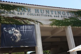 """Huntington entrance with exhibition signage for """"Three Fragments of A Lost Tale: Sculpture and Story by John Frame."""" Photo courtesy of Jill Thayer (2011)"""