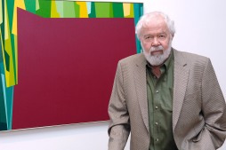 Karl Benjamin with Interlocking Forms (Big Magenta with Green) 1959 at Birth of the Cool exhibition opening in 2007_photo courtesy Louis Stern Fine Arts